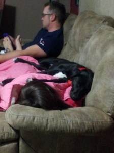 The parents of the rat finks enjoying quiet time with Gunner...he's the dog...